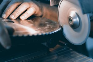 saw blade being sharpened